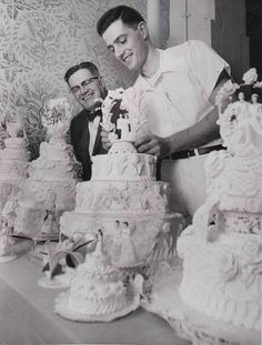 RECEPTION: Wedding Cakes beautiful decorations.  1953: Arthur Pile Sr. (left) and Arthur Pile Jr. (right) admire Hough Bakeries wedding cakes in 1953.