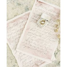 Handwritten vows with a rosy watercolor wash