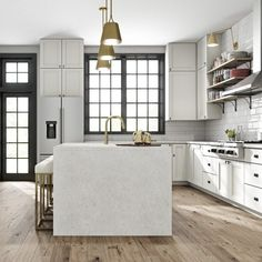 All white kitchens have a clean, minimal feel. This space is accented by natural materials, and black is also used, but in sparing, neat contrasts to offset the cleanliness of the tone.