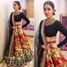Anushka Sharma wears a Sabyasachi lengha and ties up her hair in a bun. Desi look. Bollywood celebrity fashion.