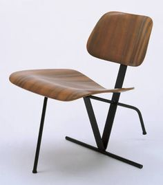"Tilt-Back Side Chair  Charles Eames (American, 1907-1978) and Ray Eames (American, 1912-1988)    c. 1944. Molded walnut plywood, lacquered steel bars and rods, rubber shockmounts, and rubber glides, 26 x 21 1/2 x 28 1/2"" (66 x 54.6 x 72.4). Manufactured by Evans Products Co., Molded Plywood Div., Venice, CA. Gift of the manufacturer"