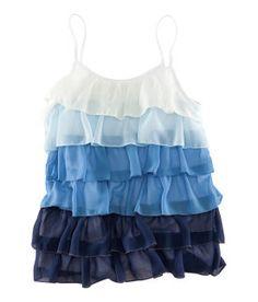 Se vería interesante un vestido con la blusa blanca, y la falda que vaya de blanco a azul en degradé, como esta.