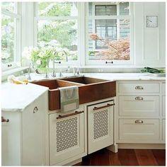 Corner apron front sink over radiator