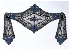Cap ca. 1860 Silk bobbin lace with applied silk flowers