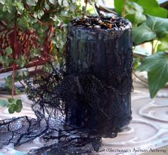 Witchcrafts Artisan Alchemy - MYSTÉRIEUX Pillar Candle w/ Tattered Black Lace,  (http://www.witchcraftsartisanalchemy.com/mysterieux-pillar-candle-w-tattered-black-lace/)