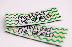 Painting the world, Woven Label with green wave effect and yellow watermark woven effect in the background.   #Woven #Green #Label #Colorful #Finotex #ImageisEverything