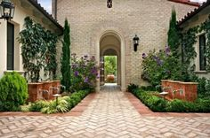WOW!!  Is this not one of the prettiest, most inviting entrances you have ever seen!?!?  And the brick walkway in the herringbone pattern is like icing on a cake. Super design!!