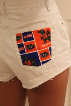 Florida Gators white cut off shorts I can do ohio state or n Carolina or Alabama or bengals etc