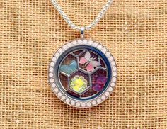 Large Silver Twist Locket Face with Rose Water Opal Swarovski Crystals, Large Silver Charm Catcher, and fun spring charms! https://vinnettelang.origamiowl.com/