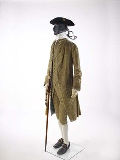 3-piece suit, 1774-1776. Cream silk velvet with small stems and flowers woven into the fabric. The colours and pattern are typical of the mid 1770s but the cut of the suit with its long waistcoat and the ample skirt of its coat harks back to the 1760s.