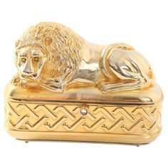 Vintage Judith Leiber Gold Lion Minaudiere | From a collection of rare vintage evening bags and minaudi�res at https://www.1stdibs.com/fashion/handbags-purses-bags/evening-bags-minaudieres/