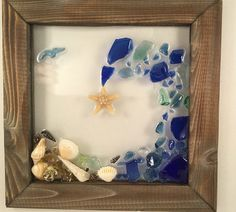 Cobalt Blue wave features Sea shells, Beach glass, sand dollar, sea glass. 10 x 10 handmade wood frame. Perfect gift! Looks great in a window,