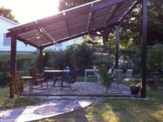 Need some shade? Need some power? Answer - solar panel pergola