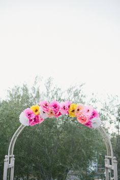 paper flower arch - photo by onelove photography http://ruffledblog.com/1920s-inspired-ace-hotel-wedding/