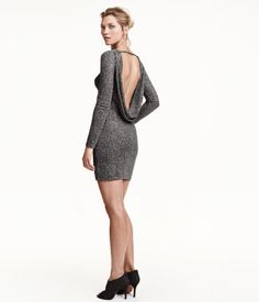 Short, fitted dress in jersey with glittery threads and a glittery printed pattern. Low-cut, draped neckline at back, horizontal strap at back of neck, and long sleeves. Jersey lining.