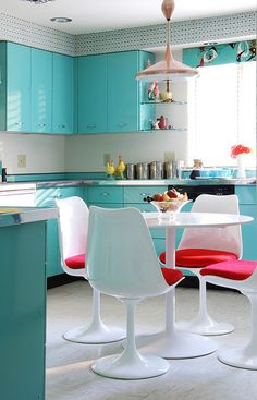 mod aqua and white kitchen with pink pops