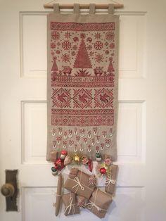 My Scandinavian cross stitch advent calendar is finally done! God Jul!