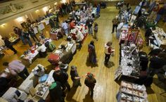 People shop the Saturday morning Oshkosh Farmer's Market held indoors at the Eagle's Club December 21, 2013.