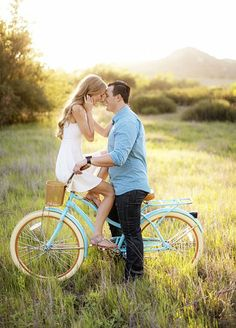 2. Play With Props - We love the romantic notion that a bicycle brings to engagement photos. Check out those 8 Cutest Engagement Photo Ideas. http://www.colincowieweddings.com/articles/engagements-celebrations/the-8-cutest-engagement-photo-ideas #EngagementPhoto #CouplePhoto