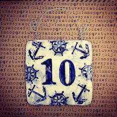 Hand made ceramic house number tile with impressed nautical anchor and sail boat wheel boarder. Works well for 1 or 2 digits but is