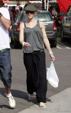 Gwen Stefani in casual grey singlet, grey cap, black baggy pant and white jandals. In Beverly Hills. (Oct 2009)