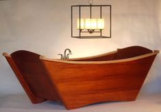 This beautiful wooden bathtub is reminiscent of a boat. I love it so much.