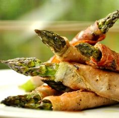 Take crescent roll, spread inside with cream cheese, and wrap around asparagus. This looks delicious!