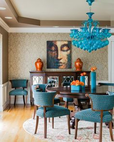 Dining room with pops of color and pattern...  I think having the 4 Chairs done in Turquoise is tooooooo much Turquoise for me...I'd like the Chandy and Vases, then stop there...