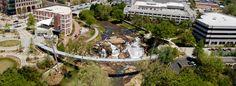 Falls Park and Liberty Bridge—waterfall park in downtown Greenville Liberty Bridge, Falls Park, South Carolina Homes, Autumn Park, City Scene, Space Architecture, Salt Lake City, Lisbon