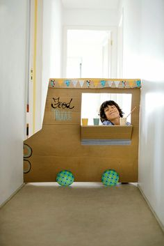 Cardboard Food Truck- DIY toy to place in a doorway or hallway for pretend play fun.