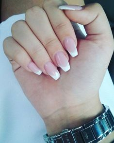 square tips on medium long, oval nails with french-style manicure, pale pink base, and white tips, on a hand with folded fingers French Nails, French Manicure Acrylic Nails, Coffin Nails Ombre, Coffin Shape Nails, Nail Manicure, Nails Yellow, White Tip Nails, White Oval Nails, Long Oval Nails