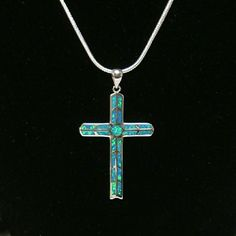 """18"""" Blue Fire Opal Cross & 925 Sterling Necklace New & Never Used! 2"""" Blue Fire Opal Cross and 18"""" 925 Sterling Silver Chain Necklace. New. NWOT Jewelry Necklaces"""