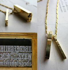Letterpress iron type necklace.