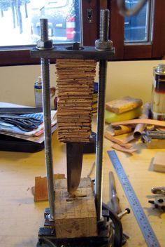 Pasi Hurttila tuohipää puukko WIP Puukko knife handle jig using Birch bark for handle in a stacked pattern.