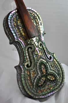 this celtic designed violin brings to mind the beautiful irish music that once came from it. now it is a work of art. the iridescent glass reflects the light in a myriad of ways, so it has a new look every time you see it. created by bill allord Mosaic Art, Mosaic Glass, Mosaic Tiles, Glass Art, Stained Glass, Celtic Music, Celtic Art, Violin Art, Violin Instrument