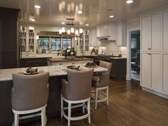A Place to Gather - Graceful Classic Kitchen on HGTV-The double islands in this large kitchen make room for extra hands – and extra visitors.