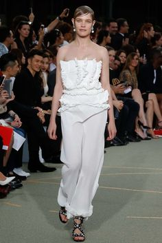 Natalia Vodianova opens the Couture section in a ruffled and multiple pleated top with softly pleated Fortuny-esque pants for the Givenchy Haute Couture Fall Winter 2016 show.