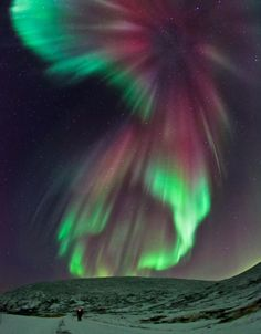 Few things can compare to the beauty of the Aurora Borealis. A tiny person standing in the foreground of this image brings to perspective the grandness of this natural phenomenon.