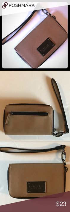 Kenneth Cole Wristlet Wallet Stylish wallet wristlet from Kenneth Cole Reaction.  Zipper pull missing-will be replaced asap. Kenneth Cole Reaction Bags Wallets
