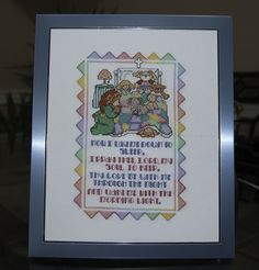 This delightful sampler will look wonderful adorning any child's nursery! Pattern was designed by Linda Gillum for Leisure Arts (C) 1997. It was created on 18 count white Aida and stitched with 3 strands of DMC thread. After stitching, it was framed in an 8 x 10 light blue metal frame.