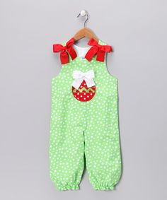A festive applique and prim bows are the delicate details that make these overalls sweet for the season. Buttoned straps and snaps up the legs are the added treats that give the gift of comfort and convenience.100% cottonMachine wash; tumble dryImported