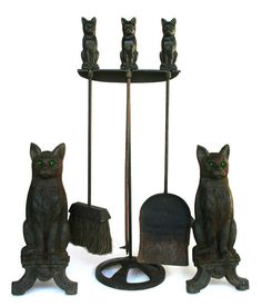 Cast iron andirons in the shape of sitting cats with three piece fire tool set - c. 1920