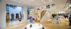 rpa:group's Interior Architecture division has designed Tommy Hilfiger's re-opened premium concept store on Amsterdam's Hoofstraat. Tommy Hilfiger Store, Tommy Hilfiger Fashion, Light Oak Floors, Nike Retail, Retail Store Design, Store Interiors, Hanging Rail, Retail Space, White Space