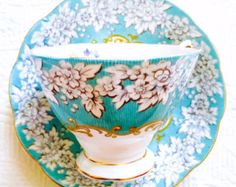 RESERVED FOR H-Royal Albert Enchantment Turquoise Floral 1940's Malvern Shape Teacup and Saucer - Edit Listing - Etsy