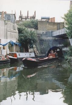 On the Regent's Canal in Lisson Grove a freight narrowboat emerges from the tunnel under the Edgware Road. Above can be seen the electricity substation on the corner of Aberdeen Place and Cunningham Place. Regents Canal, Land Surveyors, Boat Engine, London Pictures, Old Photography, Canal Boat, Narrowboat, Filming Locations, England Uk
