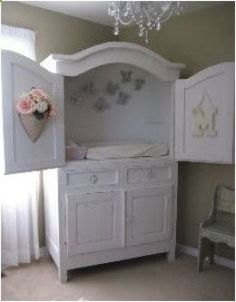 537617892771565379114 Old TV cabinet... changing table  nursery storage.   Could even put a tension rod (or 2) inside for extra hanging spac...