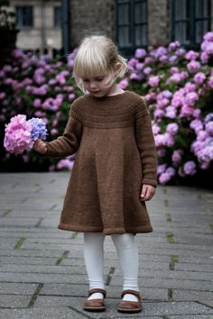 This knitting pattern is in English. Anker's Dress is worked top-down seamlessly on circular needles. The yoke consists of segments of rib st with increases fol Source by dress work Knitting For Kids, Baby Knitting Patterns, Crochet For Kids, Baby Patterns, Girls Knitted Dress, Knit Baby Dress, Girl Dress Patterns, Knit Picks, Baby Sweaters