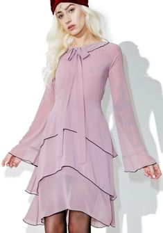 For Love & Lemons Souffle Midi Dress cuz ya always keep it light 'N sweet, bb~ This gorgeous long sleeved midi dress features a flowy semi-sheer lavender construction, long tiered skirt, bell sleeves, wide collar with extra long bow tie, black piped details, and zip back closure.