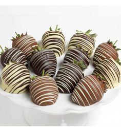 Perfectly ripe, juicy strawberries that we 've hand-dipped into luxurious white, milk, and dark Belgian chocolates, then elegantly embellished with thin ribbons of chocolate drizzle. Quantity:6 or 12 pieces