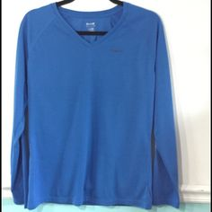Reebok long sleeved blue athletic shirt  Reebok long sleeved vneck light weight athletic top. Excellent condition.  Final Clearance Price but still eligible for bundle discount Reebok Tops Tees - Long Sleeve